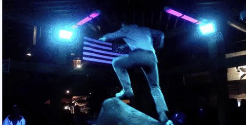 This cowboy danced on a mechanical bull while looking dapper as hell