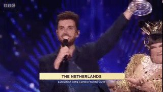 Netta hands the #Eurovision trophy over to Duncan Laurence of The Netherlands.  CONGRATULATIONS! 🎉