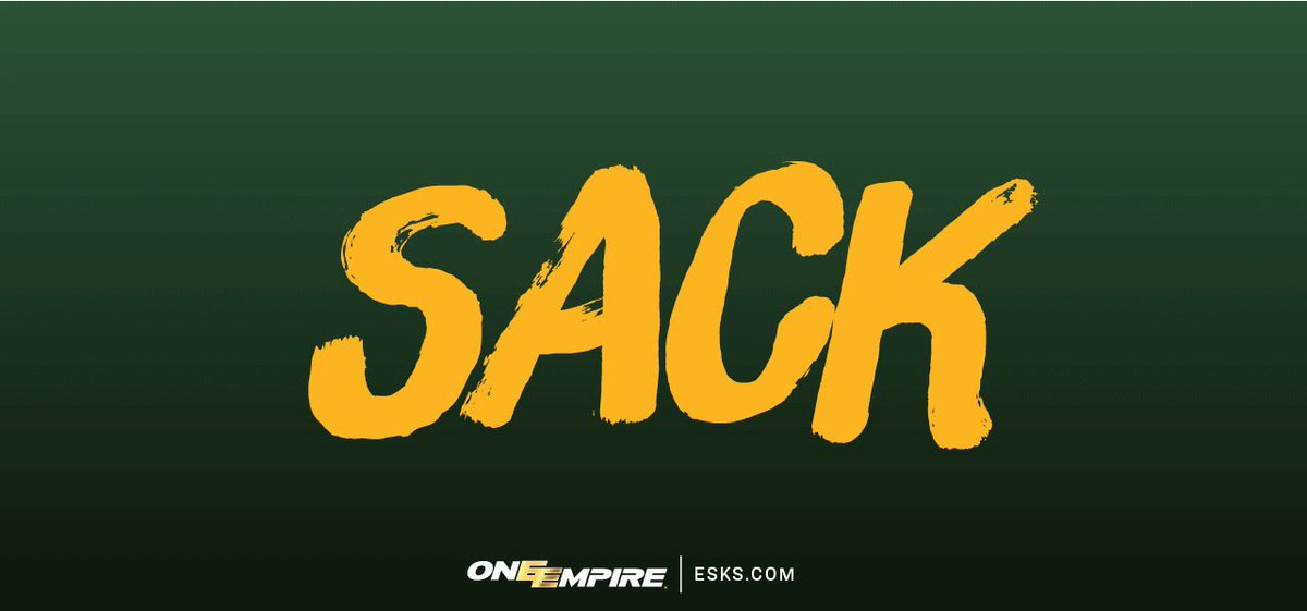 SACK!!! Mike Moore drags down Nichols for his first sack of the season...