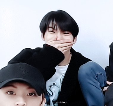 doyoung laughing (or yawning?) and smack...