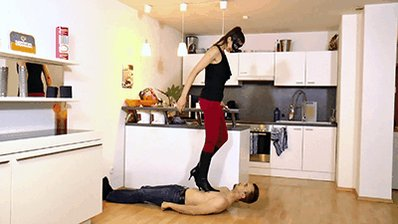 #trampling the slave with high heel boot...