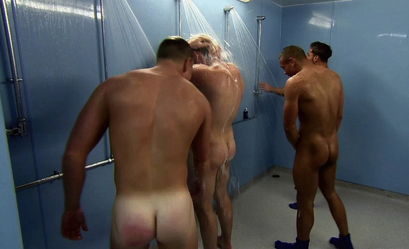 Naked men team on shower