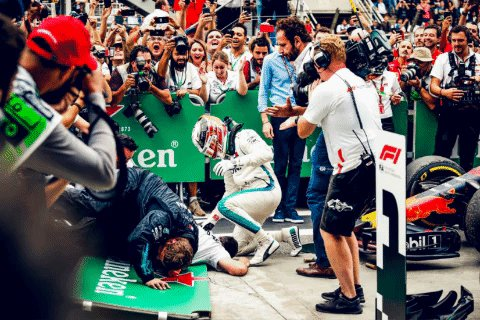 When you're so excited you literally fall over yourselves... 😂  (no mechanics were harmed in the making of this GIF)  #HiFive #F1 #BrazilGP