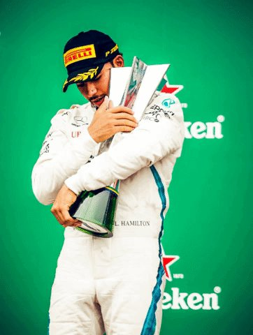 Find someone who hugs you like @LewisHamilton hugs the #BrazilGP trophy ❤️  #HiFive #F1