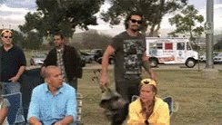 Gif: Jason Momoa opening a folding chair to sit down