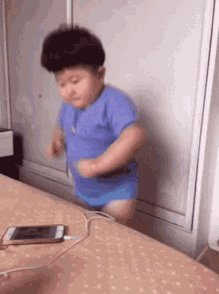 Gif of an Asian child, look...
