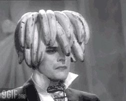 Black and white gif of Freddy Mercury of Queen (wearing 1920