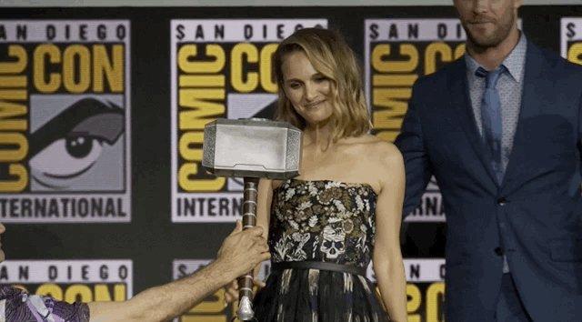 GIF of Taika Waititi handing Mjolnir to Natalie Portman to bless your timeline