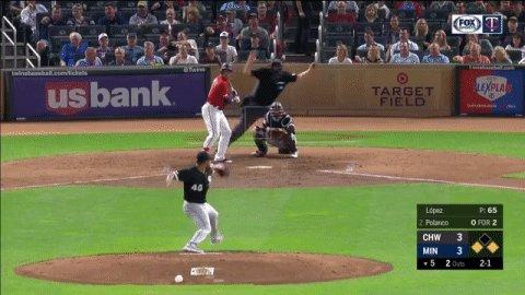 Squirrel runs through baseball player's legs