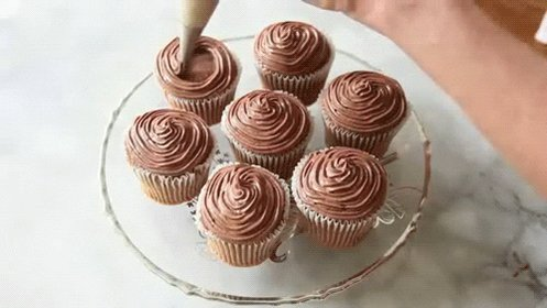 #FF @okelmann Happy #NationalChocolateCupcakeDay! 🧁I hope your day was as sweet as a chocolate cupcake! 💜 🌞 🌻 🌺