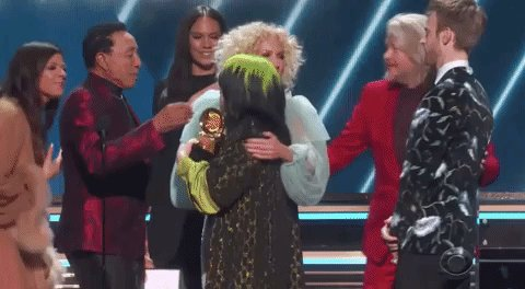 """Generations meet as @smokeyrobinson hugs @billieeilish, presenting Song of the Year for """"Bad Guy"""" at the #Grammys"""
