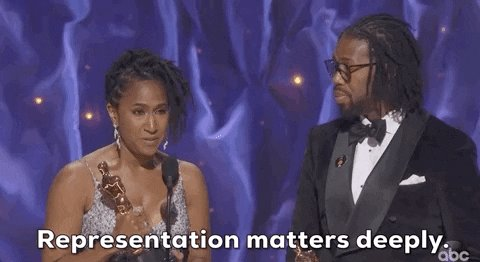 A black couple winning an Oscar saying