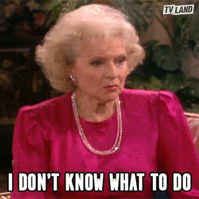 Betty White in a big pink shirt saying I don't know what to