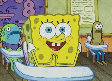 Spongebob sits at a classroom desk with enthusiastic smile.