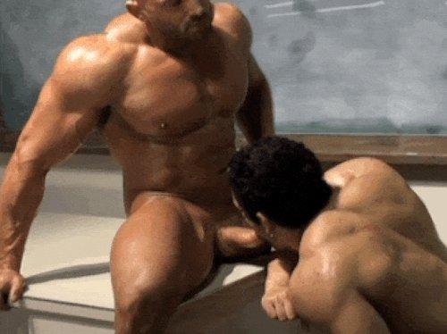 Gay bodybuilders doing oral