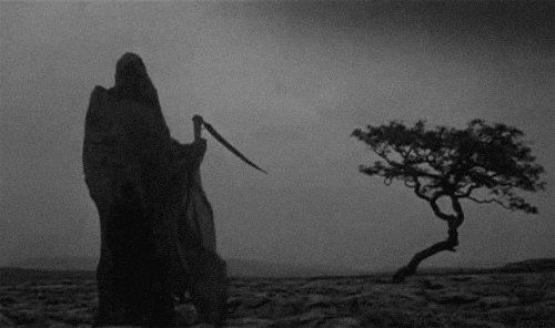 creepy grim reaper GIF