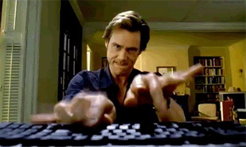 jim carrey typing GIF