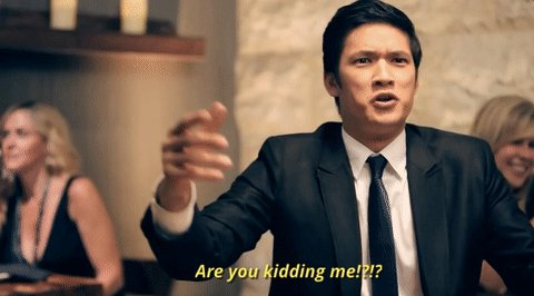 "An Asian man in a business suit saying, ""Are you kiddin"