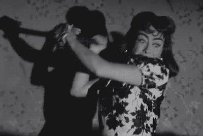 Joan Crawford as an axe-murderess in Strait-Jacket.