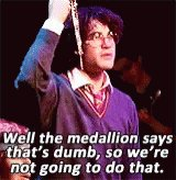 """Holding up the magic item: """"Well, the medallion says th"""