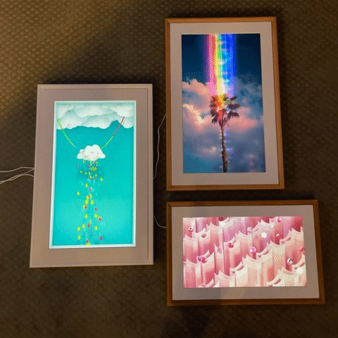 """Wow! First test of @MeetMeural gallery wall with some #NFT #cryptoart from @niftygateway.  Clockwise from top: """"Dark Paradise"""" by @cnikarts. """"Downpour"""" by @bryanbrinkman. """"The Jam"""" by @arbenl1berateme."""