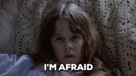 scared the exorcist GIF