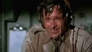 Ted Striker Sweating - Airplane GIF