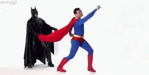 Superman And Batman Working Together - Teamwork GIF