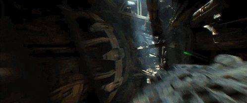 A gif of the Millennium Falcon speeding through a narrow gap