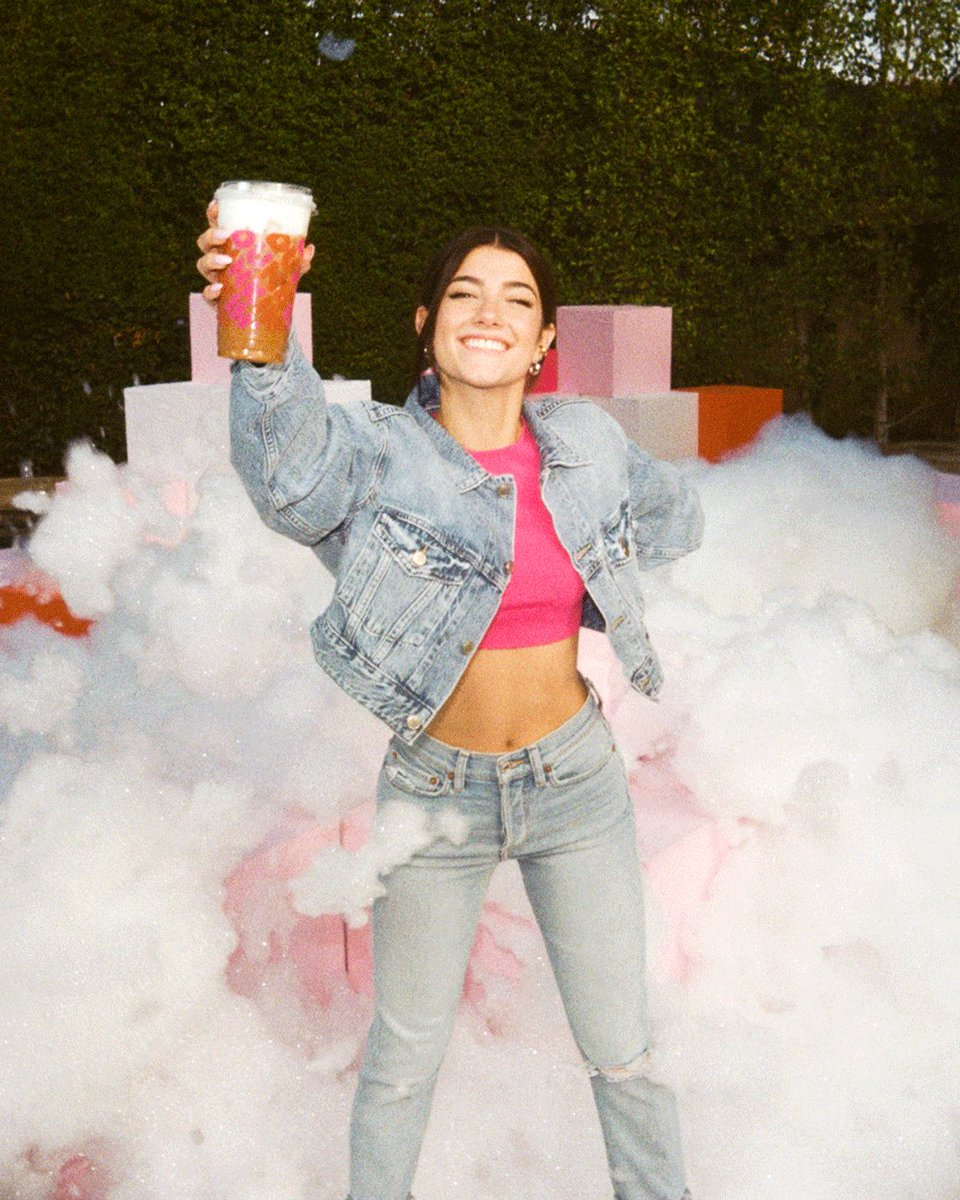 guys is this real? the loml @dunkindonuts remixed my fave drink - a cold brew with three pumps of caramel, now topped with sweet cold foam and cinnamon sugar! try the charli cold foam!! #charlidunkinremix #ad