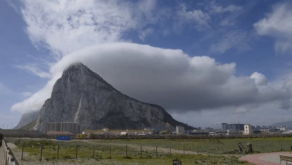 The Levante is an Easterly wind blowing in the Western Mediterranean. When it blows from the Alboran Channel and through the Straits of Gibraltar, the moisture condenses over the rock to form a long spectacular white 'banner cloud' [source of the gif: ]