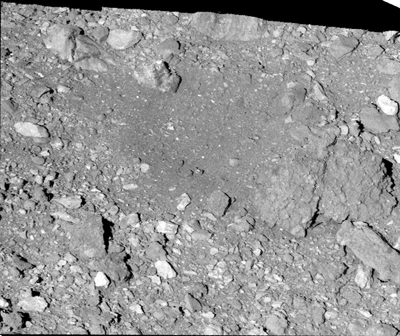 Hot off the presses! NASA's #OSIRISREx spacecraft has left its mark on asteroid Bennu. This new image, taken during the spacecraft's final flyover on April 7, reveals the aftermath of sample collection.  #ToBennuAndBack