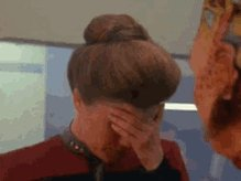 Captain Janeway elaborately rollsher eyes.
