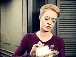 Seven of nine from Star Trek Voyager eating cake.